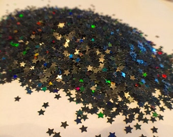 Black mini star holographic solvent resistant glitter.