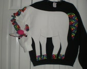 Unisex adult unicorn sweatshirt with a rainbow mane and tail. Available in your choice of color and size. Fun to wear, costume or everyday.