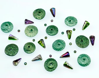 A Collection of Metallic  Green Polymer Clay Ammonites, Urchins, and Czech Glass Baby Spike Components