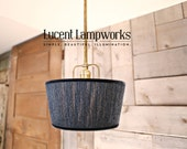 Custom Lighting with rigid raw brass downrod and hand stitched local alpaca yarn shade