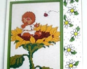 Cross Stitch Kit Friends & Flowers Emily Marmot Sitting on a Sunflower by Suzy's Zoo