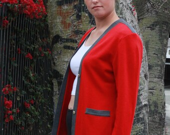 red and grey sweeter, size medium/large, knotical buttons