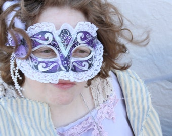 purple butterfly embellished with white hand painted carnival masquerade mask from the line moonlight masquerade