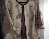 Size 1X Ivory Denim Collarless Jacket Topper With Black Paisley Stitched Design
