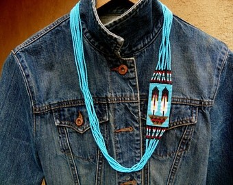 Indian made seed bead blue necklace with feather design