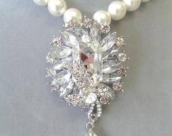 Bridal necklace with 12mm white Swarovski pearls and rhinestone pendant.