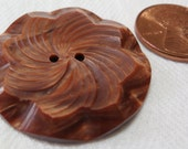 "Large vintage carved 2 hole button, streaked reddish brown, lovely swirl floral design. 1.35"" ins.WAMVI13.1-13.4-20.10."