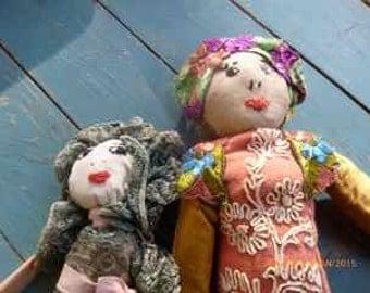 pair of vintage wrag dolls