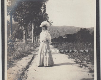 Vintage/Antique beautiful photo of a woman in gorgeous dress and hat