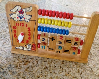 Vintage wood toy abacus rabbit with clock learning fun