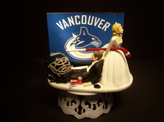 wedding cake toppers vancouver hockey sports team vancouver canucks and groom wedding 26620