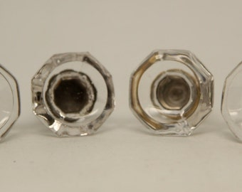 Set of four small glass knobs