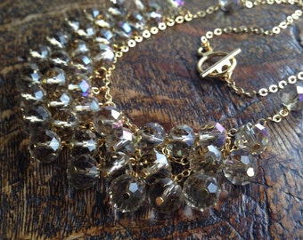 Taupe faceted glass bead statement necklace with gold chain and findings