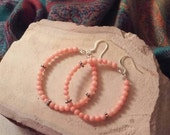 Beautiful peach colored coral and silver hoop earrings.