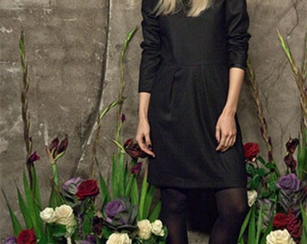 black wooldress with emphasised shoulder with red patch