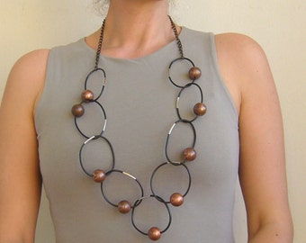 Chain necklace rubber/rubber loop necklace black and bronze