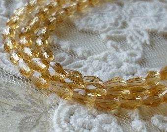3 x 5 mm 48 Faceted Cut Tear Drop Shape Golden Champagne Colour Glass / Crystal / Lampwork Beads (.mat)