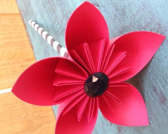 Origami Red Paper Flower Favor on Black & White Striped Paper Straw