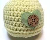 Newborn yellow unisex baby crochet hat with heart and button.  Pregnancy reveal, gender neutral, photography prop.