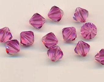 Twelve sparkling Swarovski crystals in the discontinued shape 5301: 10 mm - rose