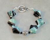 Chunky blue agate southwestern bracelet in aqua, black and natural striped stones, boho chic octahedron blue stone and silver black bracelet