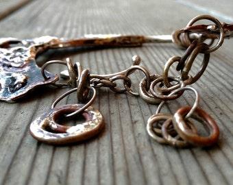 a unique sculptural  bracelet, very distinct copper and sterling combination
