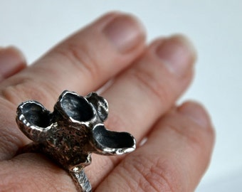 no.RI05_15. Sterling silver sea inspired carved wax ring.