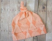 Feather Baby Top Knot Hat by JuteBaby