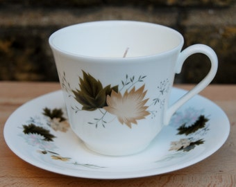 Vintage teacup candle with autumnal leaf design