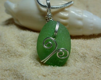 Drilled and wire wrapped green sea glass necklace with sterling silver chain