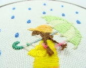 Hand Embroidered Girl with Umbrella - green umbrella with yellow raincoat, braids with pink ribbon, 4 inch wall art, custom work available