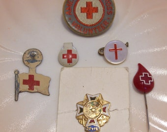 Group of Six Vintage Red Cross Pins and Fold Over Metal Tabs