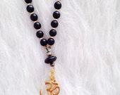 Black Onyx and 22 Karat Gold Plated Om Symbol 108 Bead Mala