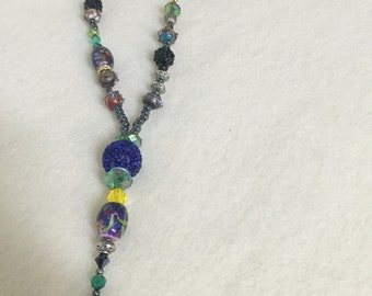 Long multi-colored necklace.