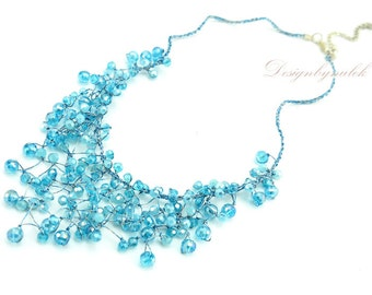 Aquamarine crystal hand knotted on silk necklace.