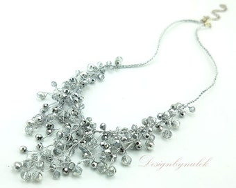 Grey crystal hand knotted on silk necklace.