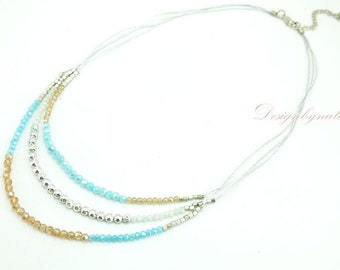 Aquamarine and topaz crystal on silk necklace.