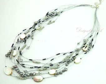 Grey freshwater pearl on silk necklace.