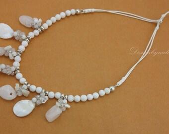 White shell freshwater pearl,quartz on cotton thread.
