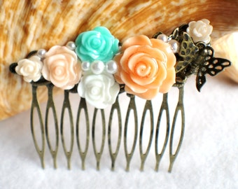 Flower hair comb in peach, mint green and cream with butterfly and leaf, wedding hair comb with resin flowers.
