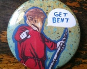 """Pinback button. """"Get Bent"""" bird man. Mixed media collage art on a button! Funny, insulting pin, badge, button. 2 1/4"""""""
