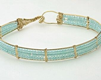 Bracelet, wire wrap with aqua glass seed beads