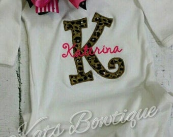 Personalized initial gown with ruffles and matching bow