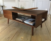 Fat Boy mid century modern coffee table with storage, featuring black walnut & tapered wood legs.