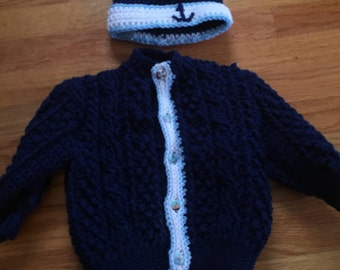 Children's sweater and hat set.