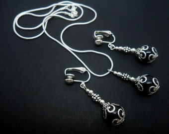 A hand made black onyx bead necklace and clip on earring set.