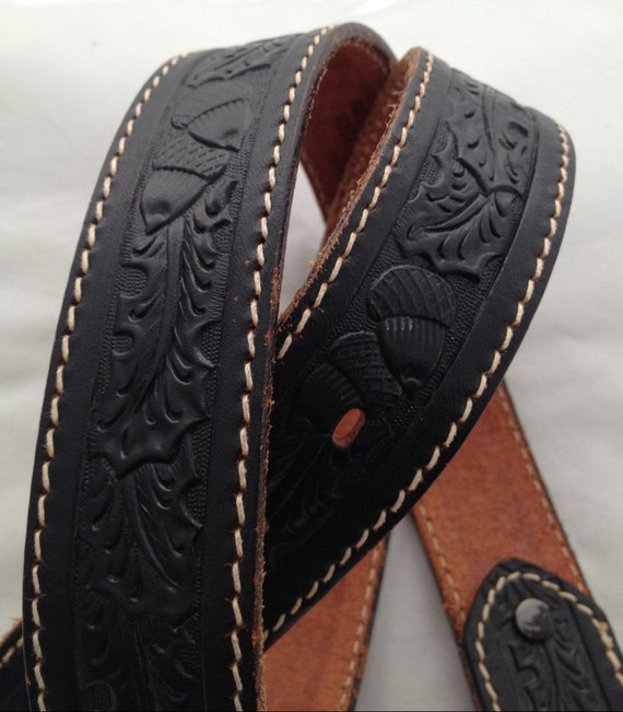 tooled black leather belt with acorn and leaf pattern in