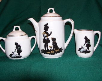 German Porcelain Children's Dishes with Silhouettes of Children and Animals