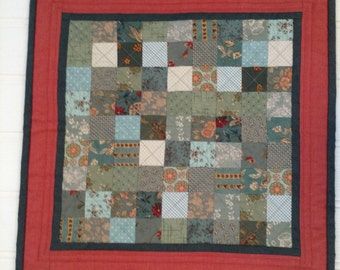Vintage style soft green patchwork table topper