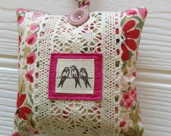 Hanging decorative mini pillow and door hanger